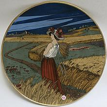 METTLACH ETCHED POTTERY PLAQUE #2899 Young Girl  with Wheat, Summer Scene and marked underfoot with incised Mettlach mark 1885-1930.  Diameter 18 inches.