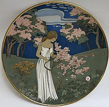 METTLACH ETCHED POTTERY PLAQUE #2898 Young Girl  With Flowers, Spring, signed H. Gradl and marked verso 2998.  Marked with incised Mettlach trademark underfoot 1885-1930. Diameter 18 inches.