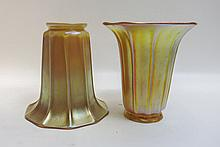 TWO STEUBEN AURENE ART GLASS SHADES, ribbed trumpet form, signed with fleur-de-lis mark, 5.25 inches tall, 5 inch diameter, made for 2.25 inch fitter.