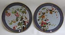 TWO METTLACH ETCHED AND GLAZED POTTERY PLAQUES,  #2350 and #2351 each of floral motifs.  Each marked with incised Mettlach trademark underfoot.  Dates 1885 - 1930.  Diameters 17 inches.