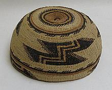 KARUK (CALIFORNIA) NATIVE AMERICAN WOVEN CEREMONIAL HAT, with Obsidian Blade and Lightning designs, made from beargrass, pine root, willow  sticks, maidenhair fern, porcupine quill dyed with grape roots.  Diameter 7.25 inches.