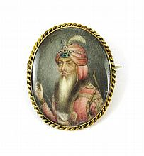 MINIATURE PORTRAIT BROOCH.  The oval portrait on  bone mounted in 14k yellow gold.  The brooch measures 1 x 1-1/4 inches.
