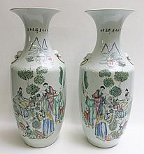 A PAIR OF CHINESE PORCELAIN VASES, Chinese Republic Period, c. 1912-1949, each a standard vase-shape vessel with molded lion/ring handles, the sides decorated with colorful enamel figures and foliate on white ground, poetic script on reverse. Height