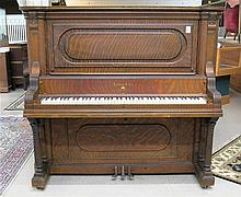 AN AMERICAN OAK UPRIGHT GRAND PIANO, Ludwig & Co., New York, serial #43836, c. 1904.  Cabinet dimensions:  56.75