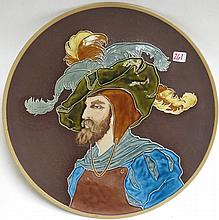 METTLACH ETCHED AND GLAZED POTTERY PLAQUE, #1168, Bearded Man with Fancy Hat, signed Warth. Mettlach trademark underfoot, 1885-1930.  Diameter 16.5 inches.