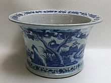 CHINESE QING DYNASTY BLUE UNDERGLAZE PORCELAIN PLANTER BOWL, a round vessel with everted rim and drainage hole, the sides featuring blue underglaze landscape with deer.  Dimensions:  10.25