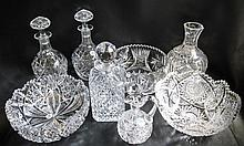 EIGHT PIECES CUT CRYSTAL in various patterns including three bowls, three stopped bottles, one open decanter and one cruet.  Bowls from 8 - 9