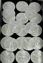 A COLLECTION OF TWENTY-ONE MEXICAN SILVER LIBERTADS, 5 troy ounce size, .999 fine silver,  64.91 mm diameter, 155.5 grams each, 3265.5 total grams (105 troy ounces).