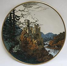 METTLACH ETCHED POTTERY PLAQUE #1365, Castle Scene, incised Mettlach logo verso, 1885-1930.  Diameter 17 inches.
