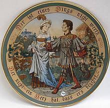 METTLACH ETCHED POTTERY PLAQUE #2288 Knight and  Lady Walking in Garden, signed Quidenus, incised Mettlach logo verso, 1885-1930.  Diameter 17.5 inches.