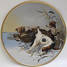 METTLACH POTTERY PLAQUE #2071, Three Dogs Attacking Boar, Print Under Glaze, signed Stocke and marked underfoot with Mettlach incised mark, 1885-1930.  Diameter 15 inches.