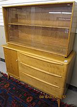 MID-CENTURY MODERN CHINA CABINET ON BUFFET, Heywood-Wakefield Furniture Co., c. 1957. The top section is an M1546 china display cabinet with sliding glass doors, on M1542 buffet with sliding tambour door left of three drawers. Overall dimensions: