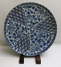 JAPANESE PORCELAIN BLUE AND WHITE CHARGER with six-character mark underfoot, Diameter 22 inches.