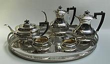 ENGLISH SILVER PLATED TEA AND COFFEE SET PLUS SERVING TRAY, seven pieces. Six piece set by J.B. Chatterly & Sons Ltd., with ebonized wood handles comprised of 2 coffee pots, 1 teapot, 1 cream pitcher, and 1 sugar bowl; together with 1 silvered tray,