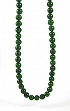 GREEN HARDSTONE BEAD NECKLACE, measuring 30-3/4  inches in length and strung with 78 green hardstone beads with diameters ranging from 9.8  to 10.4 mm.