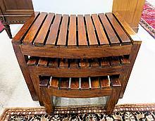 THREE-PIECE MAHOGANY NESTING STOOL SET, comprising three rectangular, graduated stools with concave slat seats.