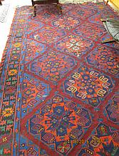 A CONTEMPORARY SOUMAK TRIBAL FLATWEAVE CARPET, hand woven in an overall geometric medallion design, the reverse featuring the characteristic unct weft strands, size 7'7