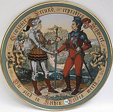 METTLACH ETCHED POTTERY PLAQUE #2287 Two Knights Shaking Hands, signed Quidenus, incised Mettlach logo verso, 1885-1930.  Diameter 17.5 inches.