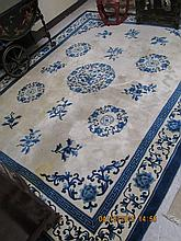 MAINLAND CHINESE CARPET, hand knotted in traditional Peking design in shades of blue in cream ground, 8'0