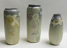 THREE WELLER ART POTTERY VASES, all with ivory to gray color ground, floral scenes and impressed