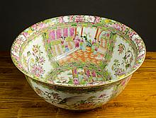 A CHINESE EXPORT FAMILLE ROSE CANTON PORCELAIN PUNCH BOWL, the interior and exterior decorated  with pictorial enamel panels filled with flowers and/or figures under an everted rim, 8.75