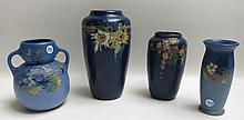 FOUR WELLER ART POTTERY VASES in blue glazes with floral decorations, two with impressed WELLER underfoot, two stamped WELLER POTTERY logo underfoot.  Heights from 7 to 10 inches.