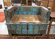 PAINT DECORATED MAHOGANY PITARA BOX SETTEE ON WHEELS, India, 18th century elements, having a rectangular box-like base with interior storage under central lift seat panel, with slide rail back and side arms.  Dimensions:  39.25