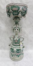 FIGURAL POTTERY JARDINIERE STAND, artist signed  at base.  Height - 33 inches.