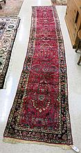 SEMI-ANTIQUE PERSIAN RUNNER, American Sarouk design of floral sprays on red ground, hand knotted, 2'5