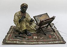 COLD PAINTED BERGMANN BRONZE SCULPTURE, Arab scribe on carpet next to opium pipe and book on stand, circa 1900. Double stamped with Franz Xaver Bergmann foundry mark (Vienna) and impressed