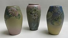 THREE WELLER ART POTTERY VASES having matte glazed floral patterns of wild rose and clematis, each with impressed WELLER mark underfoot.  One signed