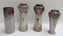FOUR WELLER ART POTTERY VASES in various high-glazed floral patterns.  Heights from 8.5 to 10 inches.