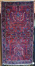 SEMI-ANTIQUE PERSIAN SAROUK AREA RUG, Arak region, northeastern Iran, c. 1920s, featuring an overall floral decorated red wine field, hand knotted, 2'6