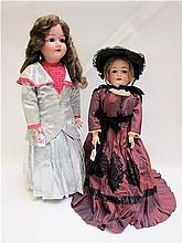 TWO BISQUE SOCKET HEAD DOLLS: German Heinrich