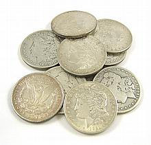 A COLLECTION OF TEN U.S. SILVER MORGAN DOLLARS: