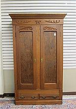 LATE VICTORIAN OAK DOUBLE-DOOR WARDROBE, American,