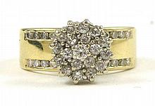 DIAMOND AND FOURTEEN KARAT GOLD CLUSTER RING. The