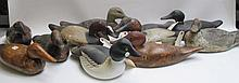ELEVEN HAND CARVED WOOD DUCK DECOYS, including