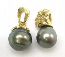 TWO FOURTEEN KARAT GOLD AND BLACK PEARL PENDANTS.