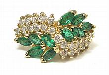 EMERALD, DIAMOND AND FOURTEEN KARAT GOLD RING, set