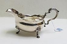 SILVER FOOTED GRAVY BOAT, hallmarked with lion
