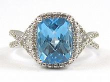 BLUE TOPAZ AND FOURTEEN KARAT WHITE GOLD RING,