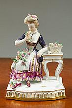 MEISSEN PORCELAIN FIGURINE, of a young woman