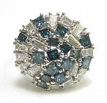 BLUE DIAMOND AND FOURTEEN KARAT WHITE GOLD RING,
