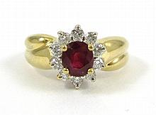 RUBY, DIAMOND AND FOURTEEN KARAT GOLD RING, with t