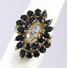 DIAMOND, SAPPHIRE AND TEN KARAT GOLD RING, with a