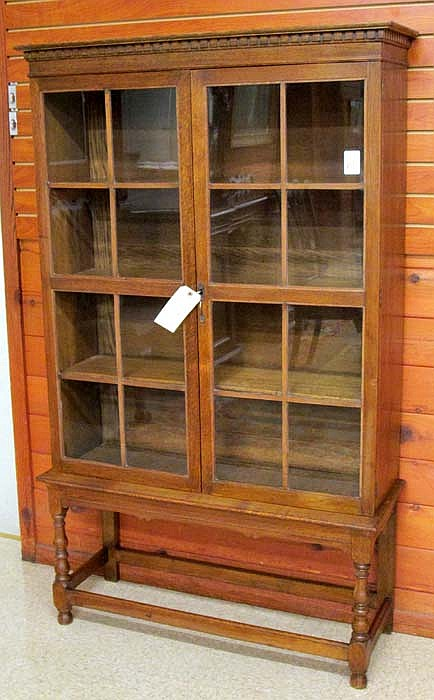AN OAK CABINET BOOKCASE ON STAND, English, early