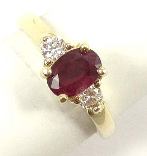 RUBY, DIAMOND AND FOURTEEN KARAT GOLD RING, with