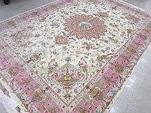 A CONTEMPORARY PERSIAN WOOL AND SILK CARPET, hand