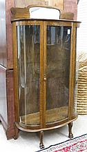 AN OAK AND CURVED GLASS CHINA CABINET, American, c